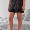 Svarta pyjamasshorts med krusad nederkant