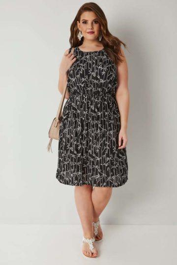 Svartvit klänning med palmtryck