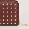 Vinröd plånbok med guldstjärnor